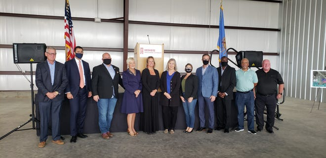 Deputy Undersecretary for International Trade Joe Semsar (second from right) joins numerous local officials at the Ardmore Industrial Airpark on Thursday.