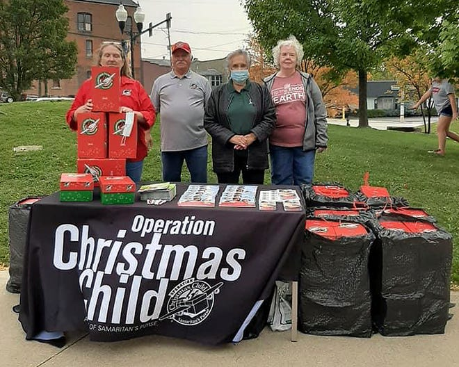 Kim Finley (left), Russell Morton, Renatha Gilmore and SueEllen George promote Operation Christmas Child during an event in downtown Ashland recently.