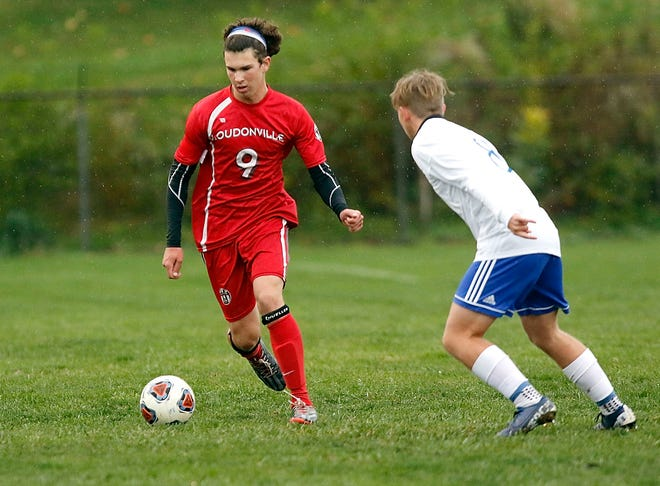 Loudonville's Trevor Portz (9) brings the ball down the field against Mansfield St. Peter's Sean Putt (8) during high school boys soccer action on Thursday at Redbird Stadium. St. Peter's defeated the Redbirds, 3-1.