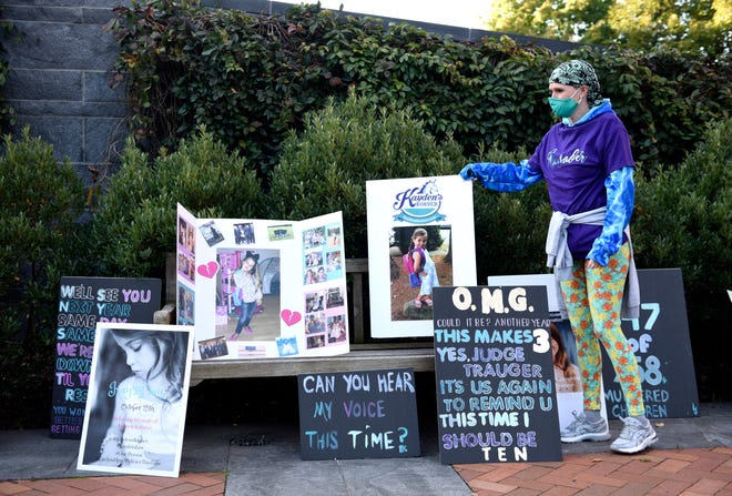 Jody McMahon, a family friend, demonstrates in front of the Bucks County Justice Center on Thursday morning on what would have been Kayden's 10th birthday.