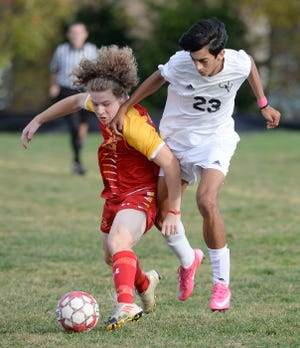 North Catholic's Devin Anderson and Quaker Valley's Keller Chamovitz (23) compete for the ball during a game at North Catholic last fall.