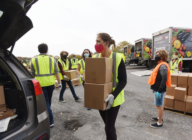 Volunteers working with the Greater Pittsburgh Community Food Bank pass out shares of food Oct. 10 at Pathway Church in Chippewa Township.