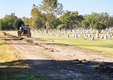 """Steve Harris, president of the Greenleaf Cemetery Association, contributed this photo of road improvements in the cemetery. Shane Agan, Greenleaf's Ground Supervisor, is reporting the City of Early-funded road improvement project has begun — a """"beautiful sight,"""" Harris said. Harris expressed appreciation n behalf of the cemetery board and staff to the City of Early for its investment in the cemetery. [Photo courtesy of Steve Harris / Greenleaf Cemetery Association"""