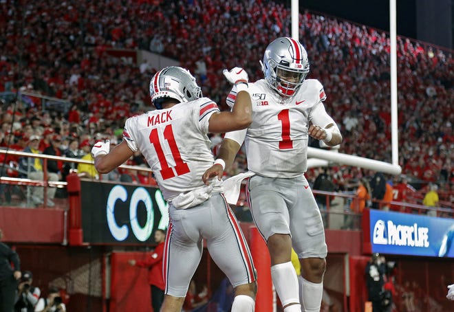 Ohio State Buckeyes wide receiver Austin Mack (11) celebrates his touchdown catch from Ohio State Buckeyes quarterback Justin Fields (1) against Nebraska Cornhuskers during the 2nd quarter of their game at Memorial Stadium in Lincoln, Neb. on September 28, 2019. [Kyle Robertson/Dispatch]