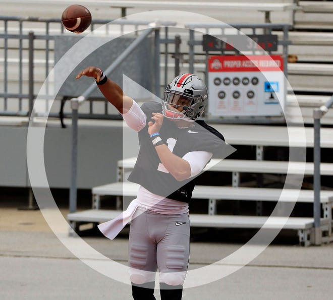 In this file photo, Ohio State Buckeyes quarterback Justin Fields (1) throws the ball during practice at Ohio Stadium in Columbus, Ohio on October 3, 2020.