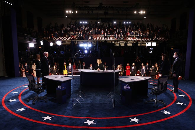 The candidates and their spouses stand on stage after the vice presidential debate.