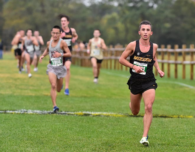Missouri's Marquette Wilhite, right, runs during the Gans Creek Classic on Oct. 3 at the Gans Creek Recreation Area.