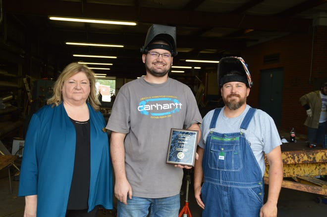 Chipola Vice President of Instructional Affairs, Dr. Pam Rentz; Cody Baxter and Welding Instructor Curtis Jenkins.