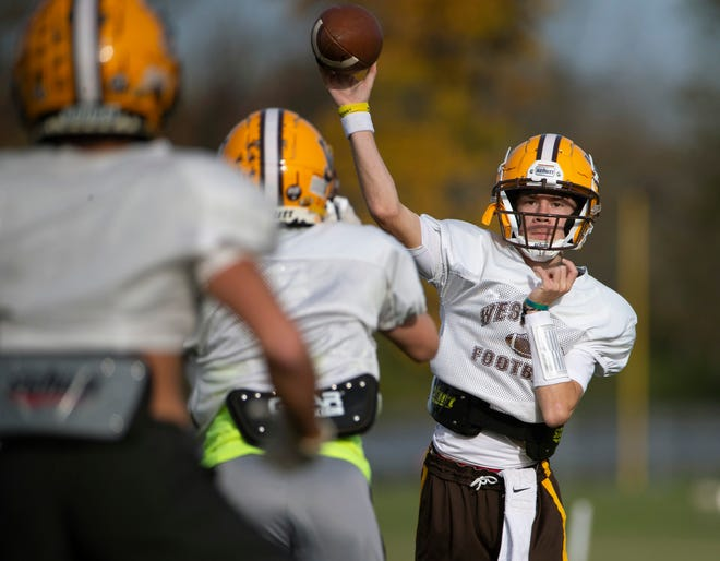 West Jefferson quarterback Tyler Buescher throws a pass during practice at the high school on Wednesday. The Roughriders will face Anna in their second round playoff game Saturday.