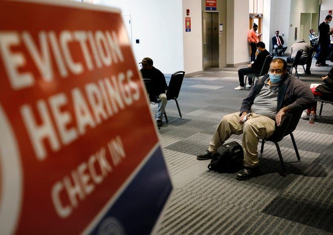 Columbus resident Julian Hoe, 38, was among dozens of renters waiting for hearings on their eviction cases Thursday at the Greater Columbus Convention Center, where Franklin County Municipal Court moved its traffic and eviction dockets. Hoe lost his previous job and hopes to be able to catch up in a new position as a security guard.
