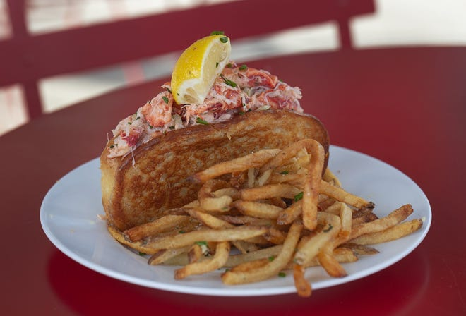 The Maine Lobster Roll from Coastal Local Seafood in the North Market, lets the lobster shine without a lot of additions.
