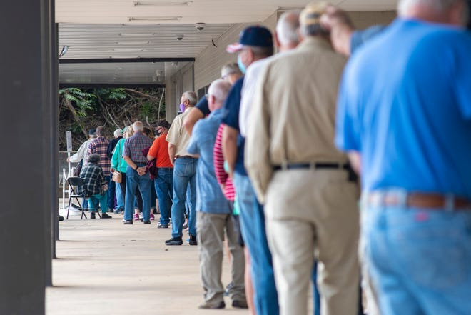 Randolph County voters wait in line at the Board of Elections Building on North Fayetteville Street for the first day of early one stop voting. More than 50,000 people at the polls in early voting alone.