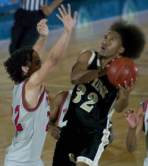 In the 2005 photo, East Ridge forward Richard Jackson shoots against Clearwater defender Trevor Lee during the Florida High School Athletic Association Class 5A Boys State semifinals at The Lakeland Center in Lakeland. Jackson is one of five who are set to bet inaugural class of inductees into the East Ridge Athletic Hall of Fame. [David Mills/The Ledger]