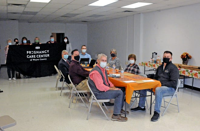 The Pregnancy Care Center board and staff members celebrated the purchase of a new building with a lunch at the site. Renovations are expected to begin after the first of the year, and the center will change locations in the spring.