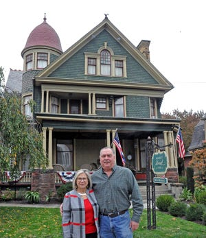 Market Street Inn owners Mary Joy and Tom Lynch stand in front of the bed and breakfast in downtown Wooster. A grant from the Wayne County Small Business Relief program will help them pay their mortgage this year after the inn saw more than 600 cancellations this spring and summer due to the coronavirus pandemic.