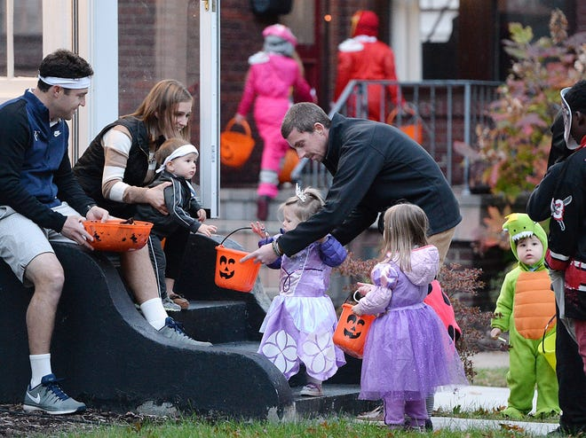 Trick-or-treating in Erie, shown here on Vermont Avenue in 2016, will be held from 6 - 8 p.m. on Oct. 31. Mayor Joe Schember gave the Halloween ritual the OK on Thursday, despite COVID-19 concerns.