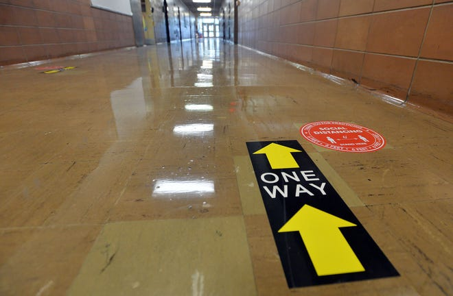 Directional signs are placed every few feet in hallways at Grover Cleveland Elementary School in Erie.