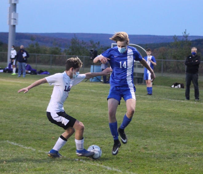 Alfred-Almond's Cameron Claire hops past a defender during Wednesday's win over Hammondsport in Almond.