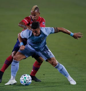 Sporting KC's Erik Hurtado, front, shields the ball from FC Dallas' Michael Barriosduring the first half of their MLS game in Frisco, Texas, Wednesday. Sporting KC loset 1-0.