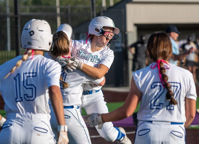 Blue Springs South's Ella Westhoff, center, leaps into the arms of teammate Mya Bristow to celebrate after scoring the winning run in a 5-4 walk-off victory over Lee's Summit in a Class 5 District 7 semifinal Wednesday at Blue Springs High School. The Jaguars advanced to Thursday's championship against Lee's Summit North.