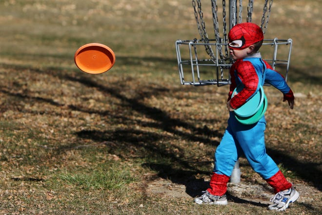 Jacob Pollmeier, 4, of Mount Pleasant tries his hand at disc golf Oct. 27, 2013, during the Healthy Halloween Walk, hosted by the the Healthy Henry County Communities at East Lake Park in Mount Pleasant. Healthy Halloween Walk is 2 to 5 p.m. today at East Lake Park in Mount Pleasant, with games as participants walk through the park, starting by the tennis courts or softball diamonds. Stations will be interactive, with social distancing and masks.