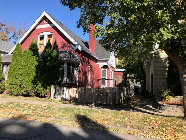The home at 1428Cleveland St. is boarded up after a house fire Saturday in Burlington. The home, a two-story single family house owned and occupied by Curtis Heath, sustained an estimated $30,000 indamages and was not insured.