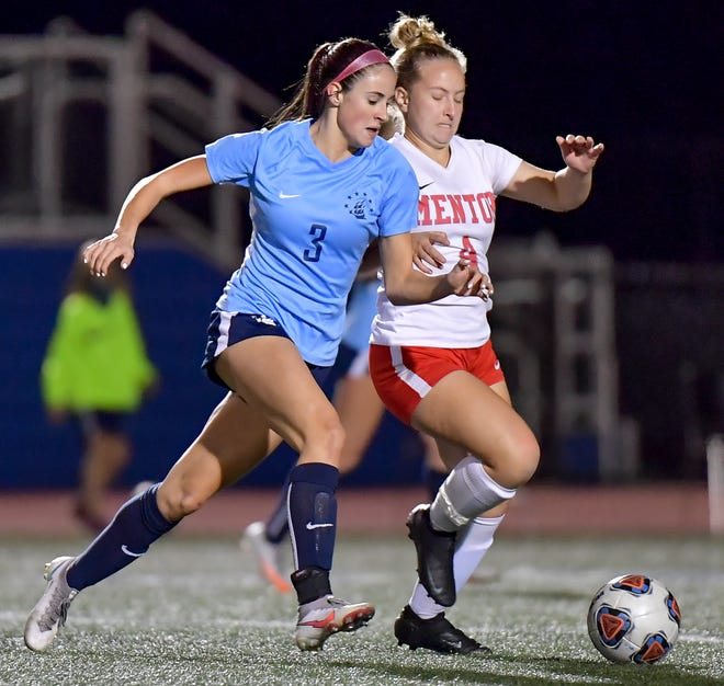 Hudson forward Reagan Miele pushed the ball ahead of a Mentor defender during the Explorers' 1-1 home draw with Mentor Oct. 14.