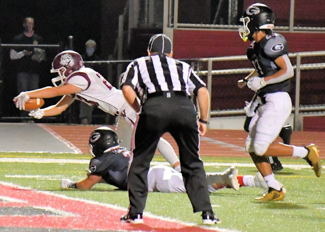 Woodridge running back Owen Snyder leaps for the end zone during the Bulldogs' 42-21 playoff loss at Girard Oct. 10.