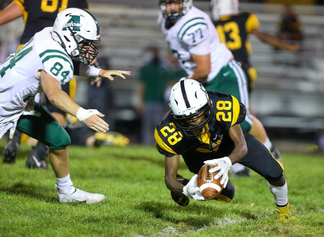 Cuyahoga Falls senior Isaiah Campbell dives to the secure the ball during a game against Aurora earlier this season.