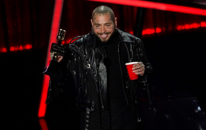Post Malone accepts the top artist award at the Billboard Music Awards on Wednesday, Oct. 14, 2020, at the Dolby Theatre in Los Angeles. (AP Photo/Chris Pizzello)