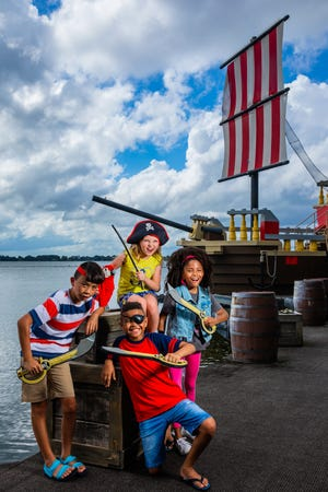 Young guests pose at the site of the Brickbeard's Bounty ski show on Lake Eloise at Legoland Florida Resort. Legoland announced plans for a new watersports show that will introduce a female Pirate character.