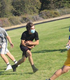 Mount Shasta High School senior JT Kennedy during a practice at Joe Blevins Memorial Stadium.