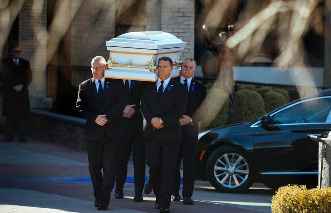 Pallbearers carry the casket after the funeral service for 8-year-old Thomas Valva at St. Elizabeth's Church in January, in Melville. The boy's father Michael Valva, a New York City police officer, and his fiancee, Angela Pollina, are being charged with Thomas's death.