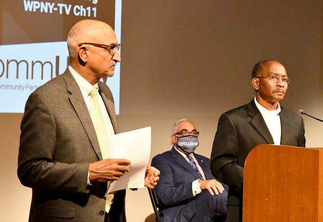 Patrick Johnson, consultant on race relations, right, joins Anthony Colon, vice chairman of MVCC Board of Trustees, center, and Frank Anechiarico, from the Department of Government at Hamilton College during the September launch of the College/Community Partnership for Racial Justice Reform at Munson-Williams-Proctor Arts Institute in Utica.