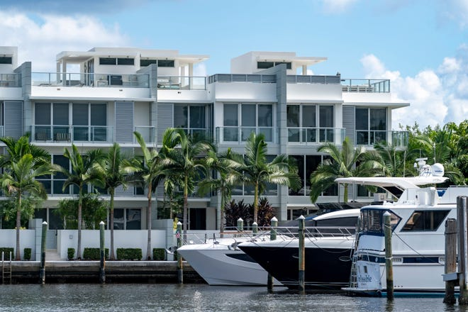 Townhomes at Seagate Yacht Club have third-floor terraces that feature kitchens and gas pits that are above the 35-foot height limit in Delray Beach, Florida on October 14, 2020. (GREG LOVETT / THE PALM BEACH POST)