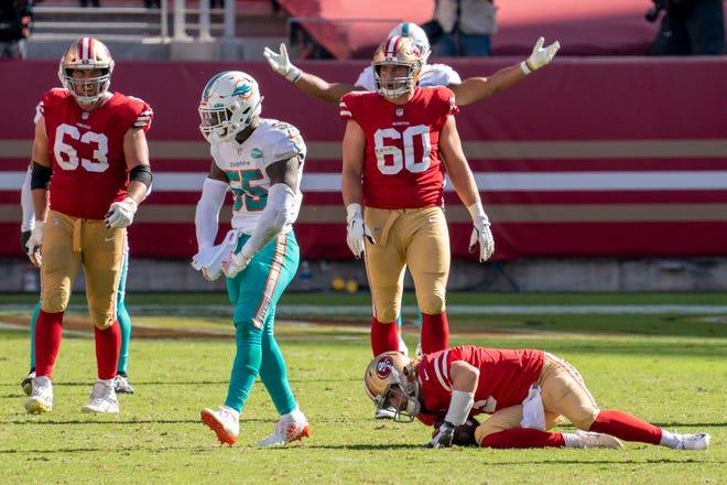 Dolphins linebacker Jerome Baker celebrates after sacking 49ers quarterback C.J. Beathard during last Sunday's game at Levi's Stadium.