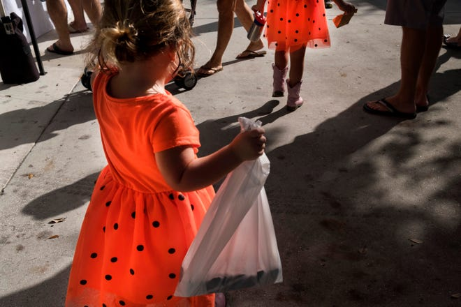 Emerson Hickey (left) and her sister Mayer sport matching pink cowboy boots and dresses at the Gardens GreenMarket in this 2017 photo.  The event returns Sunday in a new socially distanced format.