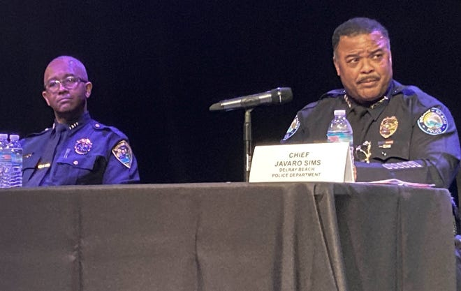 Boynton Beach Police Chief Michael Gregory (left) and Delray Beach Chief Javaro Sims address questions Wednesday at a policing forum at the Arts Garage in Delray Beach.