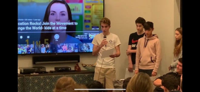 Cameron Silverman, left, talks during an event for the Mitzvah Dessert Club in his home early this year. Due to the pandemic, Mitzvah Dessert Club is prepping to do Zoom calls with members instead of in-person meetings