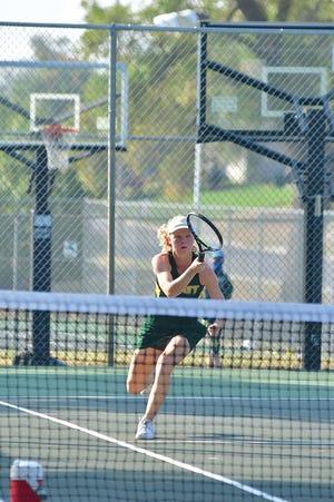Erin Jackson, Pratt High School senior tennis player, works the net at the Regional Tennis Tournament Saturday in Pratt.