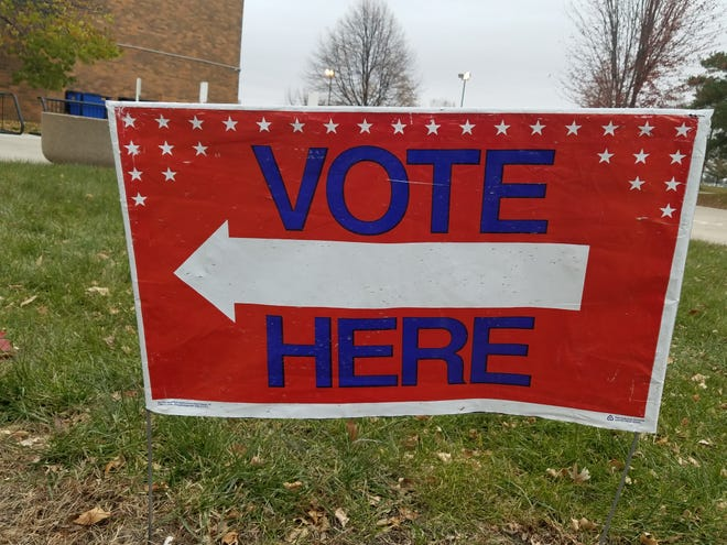 A 'Vote Here' sign outside of the McCreary Community Building.