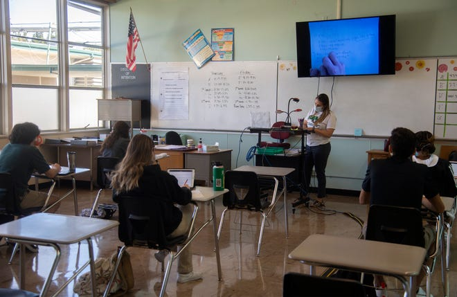 Calculus teacher Angela Solorio conducts a class of five in-person students as well as online at St. Mary's High School in Stockton on first day of the school's reopening under a hybrid model.