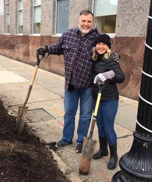 One of the reasons, Mike Lewis received the volunteer of the year award is that he volunteers in all sorts of ways, not just as a financial helper for Main Street Kent. Here, he's planting tulips with Main Street Kent Board member Julie Kenworthy.