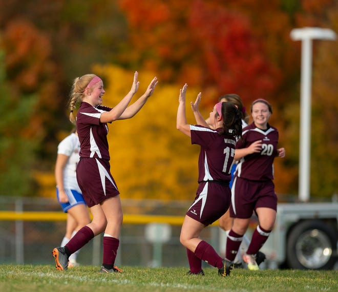 Waterloo's Rose Couts celebrates a goal with Grace England and teammates Wednesday.