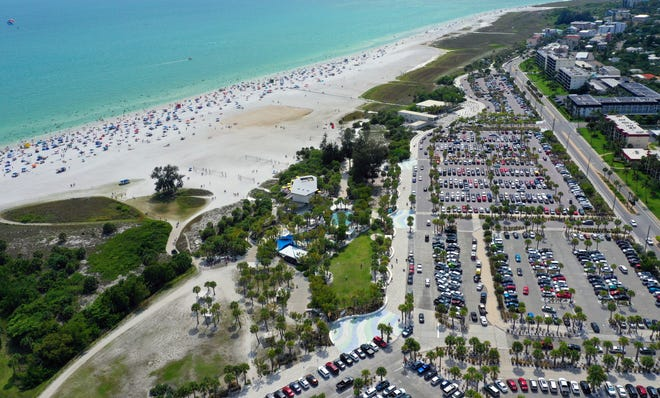 Opponents of proposed high-rise hotels near Siesta Beach say the projects could pose a safety hazard and inhibit public access. Already, parking can be difficult to find on many days, such as this one in May.