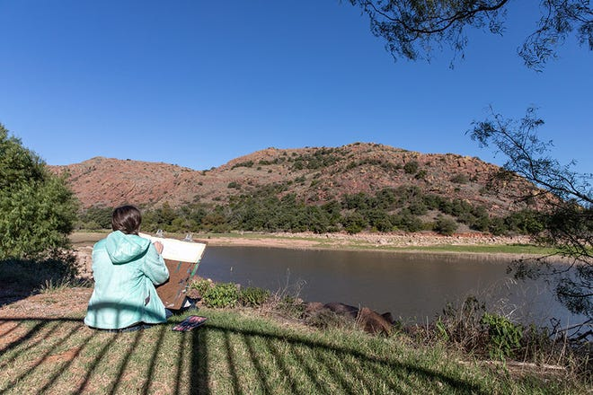 A past participant of the Oklahoma Fall Arts Institute is shown at Quartz Mountain during a workshop.
