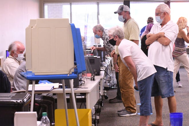 Pat and John Murray gets ready to vote at the New Hanover County Government Center as thousands of voters came out Thursday Oct. 15, 2020 for early voting ahead of this year's general election during the one-stop early voting period.  The general election is on Nov. 3.