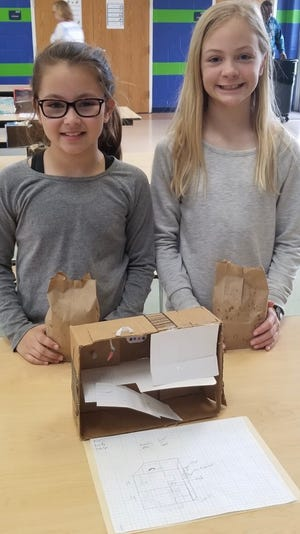 Pictured, two of the students who helped with the Bunny Hutch project. [CONTRIBUTED PHOTO]
