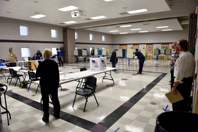 Social distancing is observed inside the early voting center at the Kiwanis Recreation Center in Fayetteville on Oct. 15. Observer reporters will be reporting on Tuesday's election throughout the day on our website and on social media.