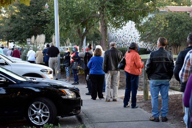 Voters line up at Kiwanis Recreation Center in Fayetteville on Thursday.
